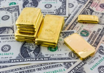 24876084-Gold-bar-on-a-heap-of-american-dollars--Stock-Photo